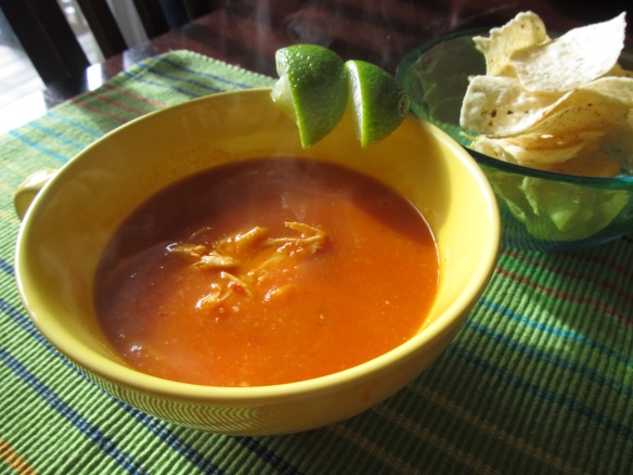 tortilla soup with tomatoes, chicken and lime
