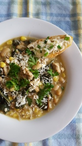 White bean chili with chicken sausage and parmesan crostini