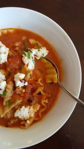 creamy tomato soup with lasagana noodles and italian chicken sausage and dollops of ricotta cheese