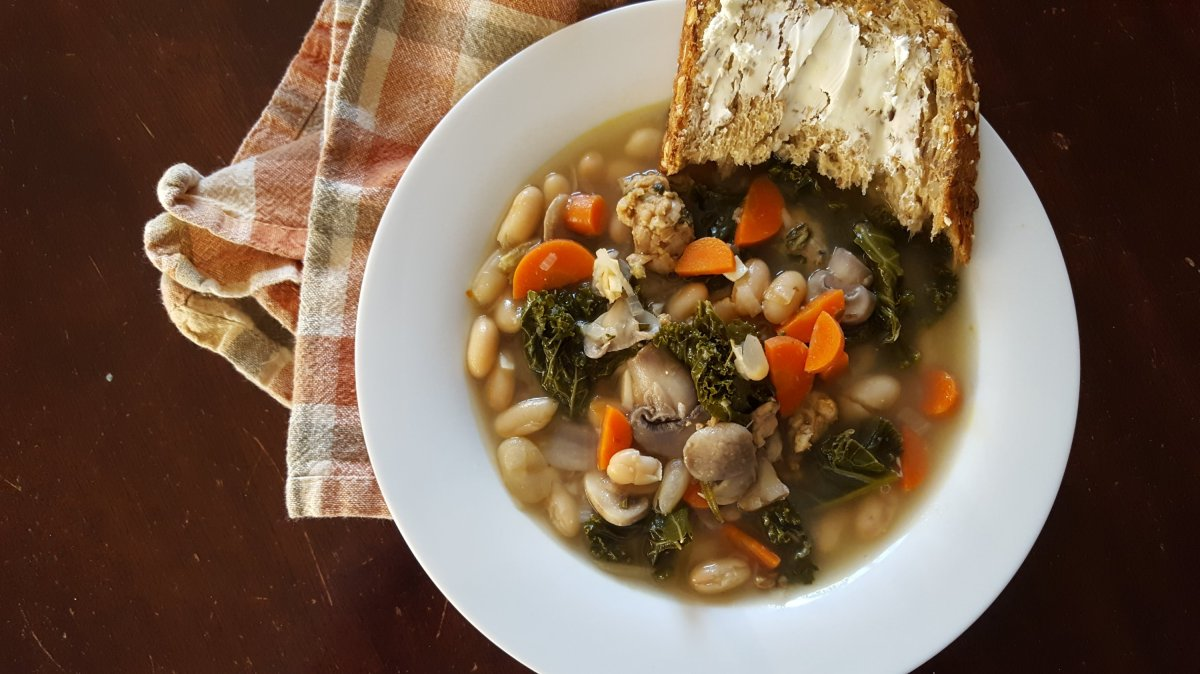 soup with white beans, carrots, kale, mushrooms and chicken sausage