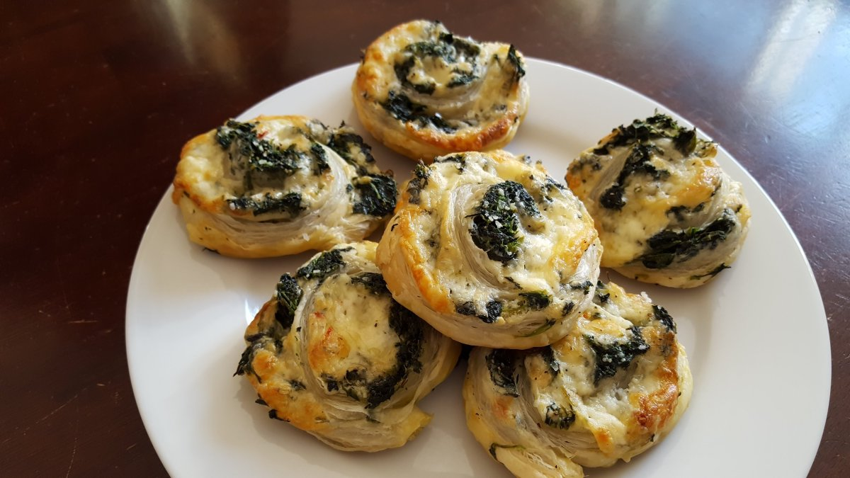 spinach, sharp cheddar cheese, garlic pub cheese rolled up and baked in puff pastry