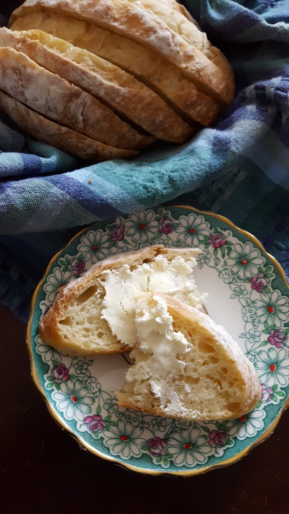 no knead bread loaf and bread slice with butter