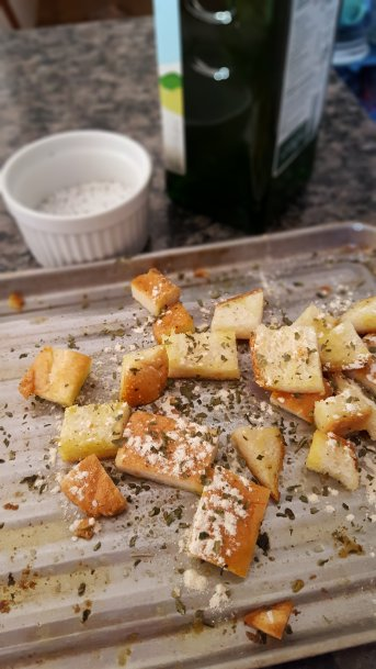 croutons made out of bread heels with olive oil, salt, pepper and spices