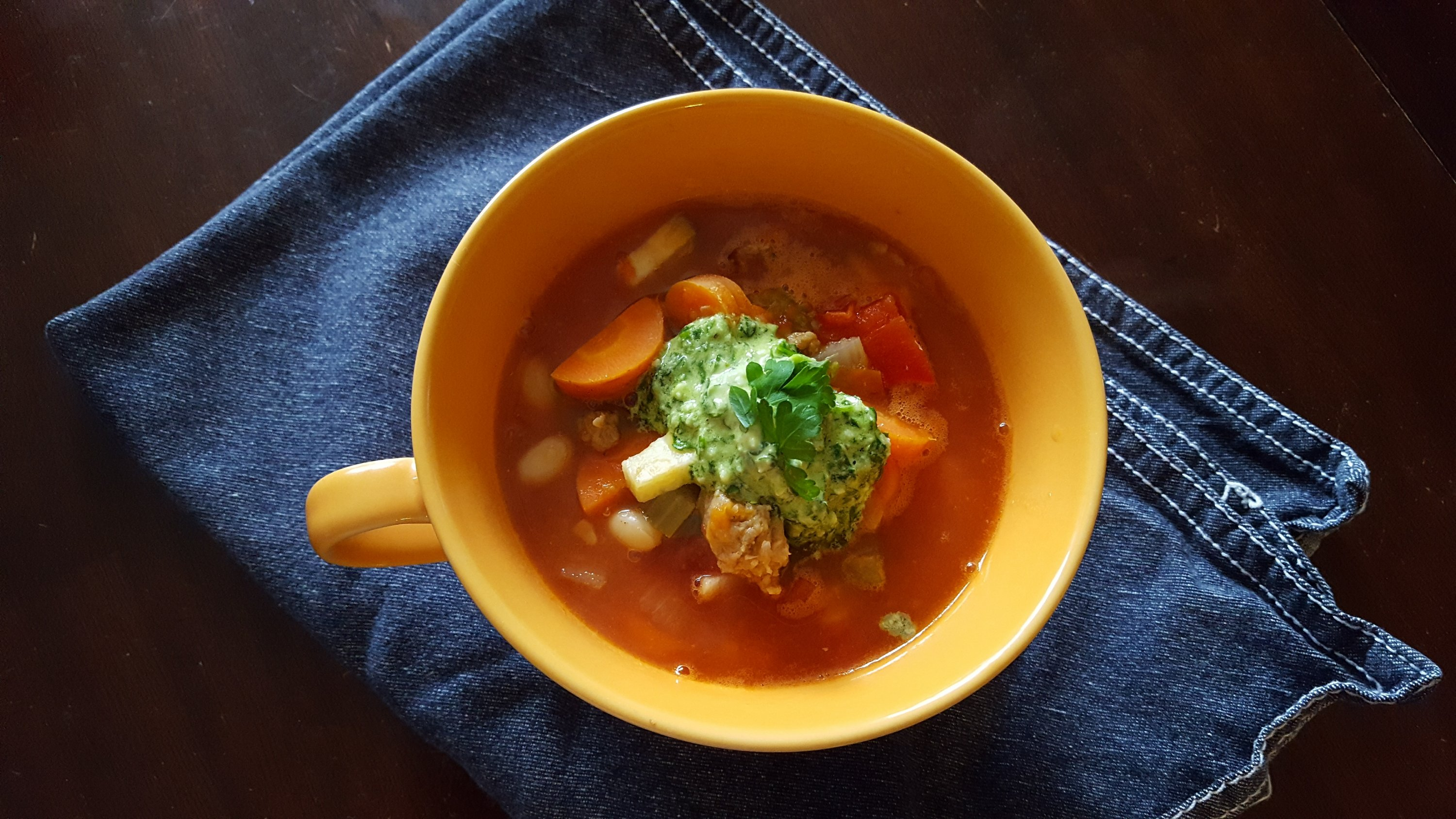springtime vegetable soup, carrots, white beans, parsley and Parmesan cheese puree on top