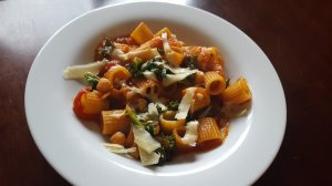 white bowl of Kale, Pasta and Chickpea Stew with Parmesan cheese